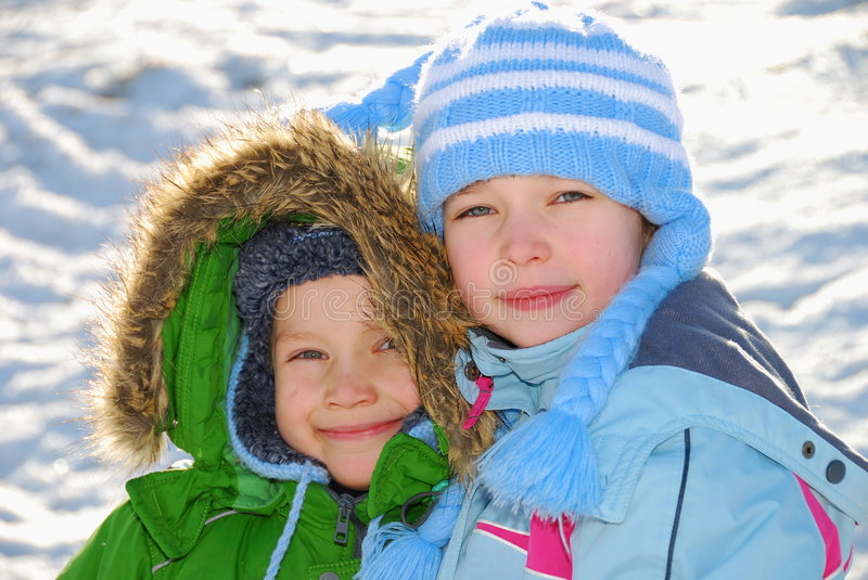Download Siblings in winter clothes stock image. Image of posing - 4070367