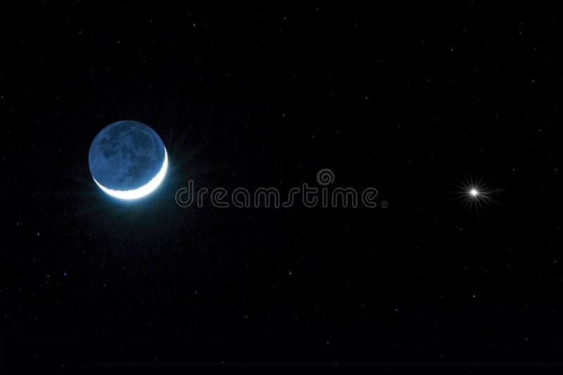 Sichelförmiger Mond und Venus stockfoto