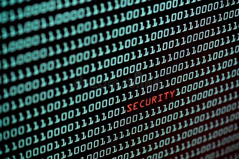 Sicherheitstext und binär Code-Konzept vom Tischplattenschirm, selektiver Fokus stockfoto