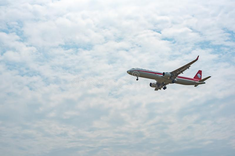 Sichuan Airlines Airbus A321 commercial airplane against sky stock images