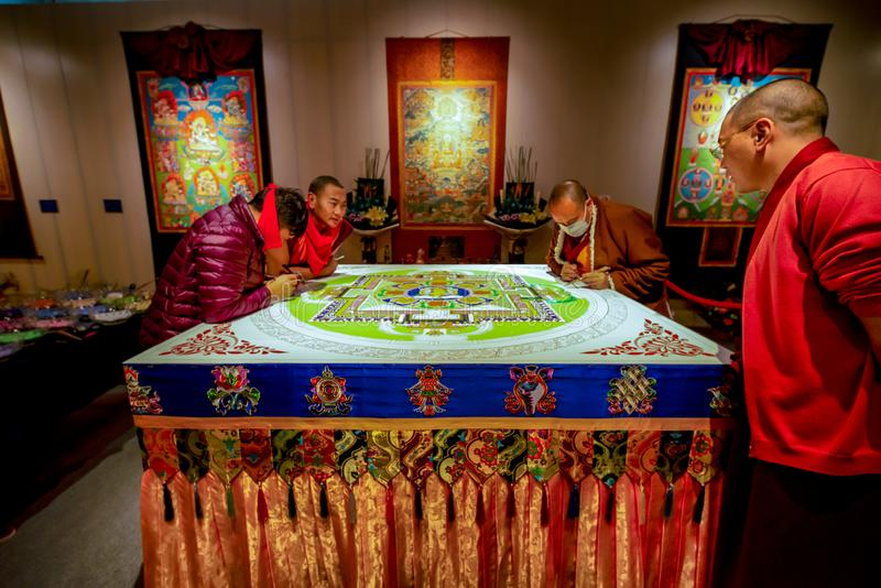 Sichuan monks creating sacred Buddhist art, Shenzhen stock image