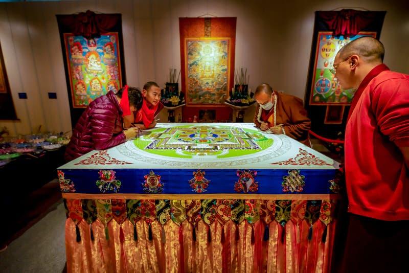 Sichuan monks creating sacred Buddhist art, Shenzhen stock image