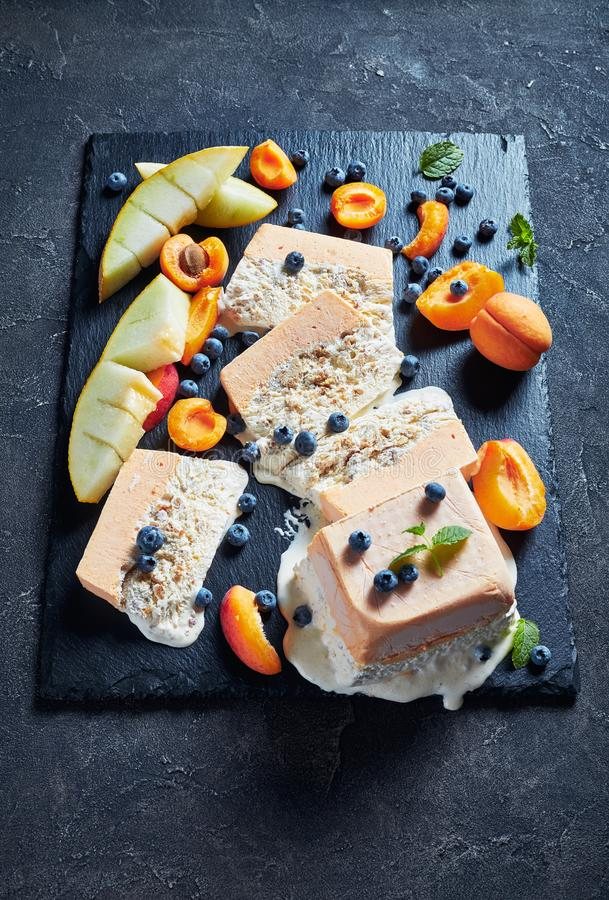 Sicilian Almond Semifreddo with apricot and melon. Italian summer dessert, melting Semifreddo alle Mandorle, Sicilian Almond apricot melon Semifreddo served on a stock images