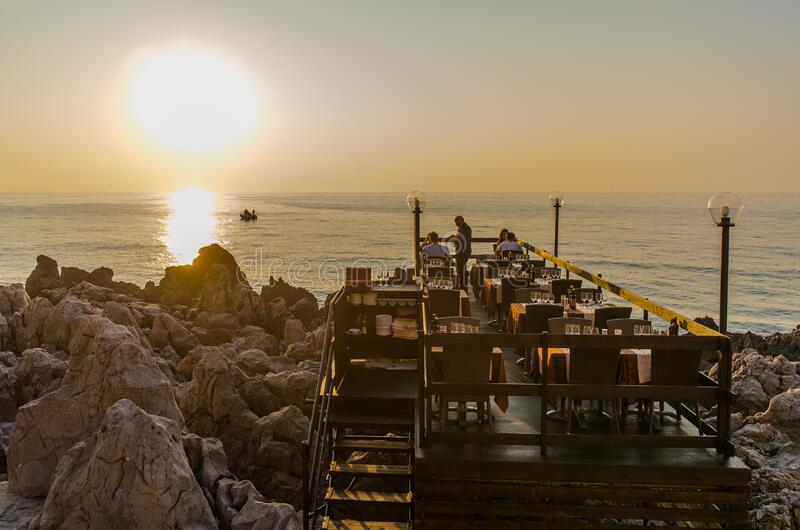 Sicilian seaside restaurant during sunset royalty free stock images