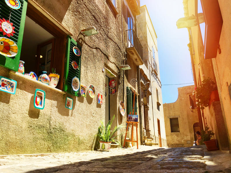Sicilian souvenirs. Ancient, typical narrow and cobblestone street in Erice, Sicily, Italy. royalty free stock photos