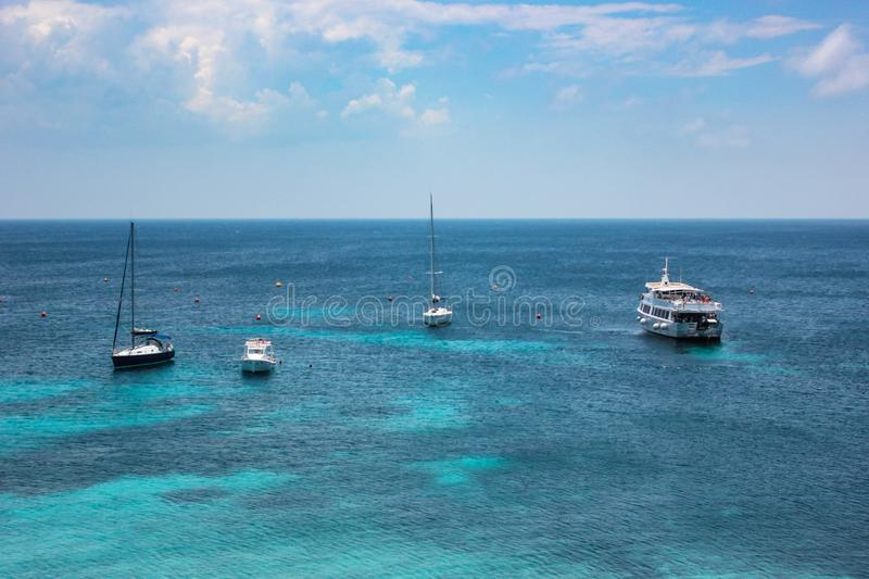 Boats and Ships off the Coast of Sicily stock photo
