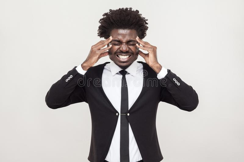 Sick afro man have a headache and migreine. stock photography