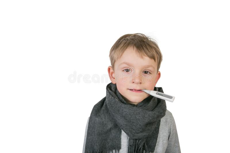 Sick boy holding themometer in mouth royalty free stock image
