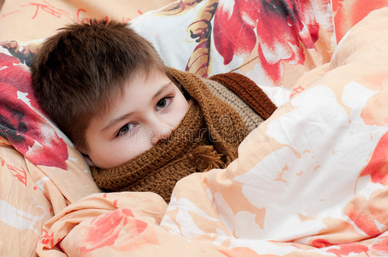 Download Sick boy lying in bed stock photo. Image of throat, blanket - 27884630