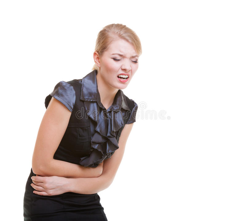 Sick business woman with stomach ache pain. Trouble in work. Sick businesswoman with stomach cramps. Ill blonde girl with ache pain. Trouble in work. Business royalty free stock images