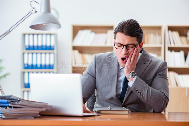 The sick businessman in the office. Sick businessman in the office stock images