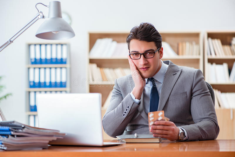The sick businessman in the office. Sick businessman in the office stock photo