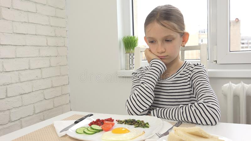 Sick Child Couldn`t Eat Breakfast in Kitchen, Looking Food Meal, No Appetite stock photography