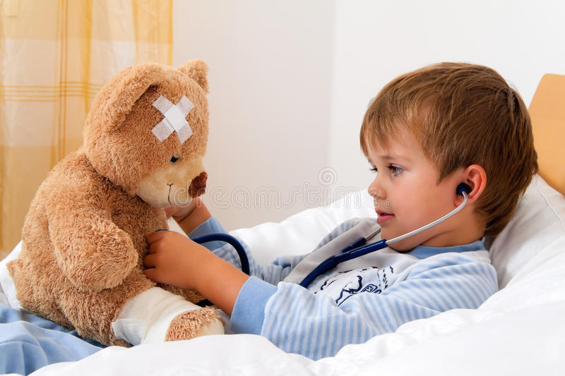 Sick child examined stock images