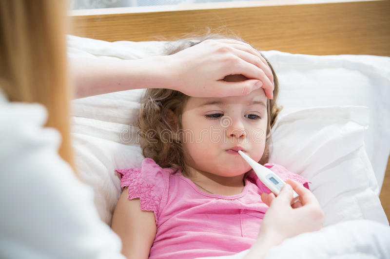 Sick child with fever royalty free stock photos