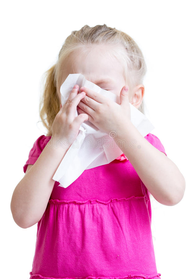 Sick child wiping or cleaning nose with tissue isolated royalty free stock image