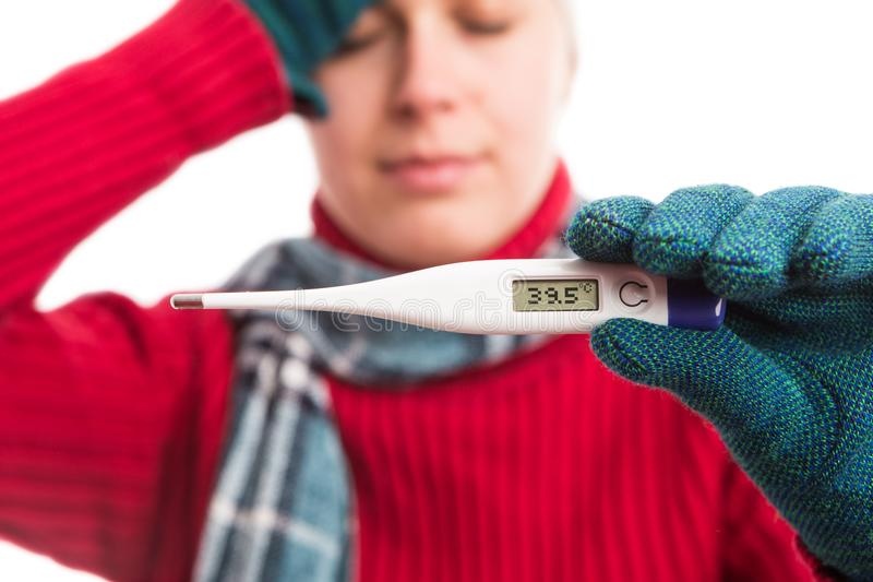 Sick cold woman showing thermometre with high temperature stock photos