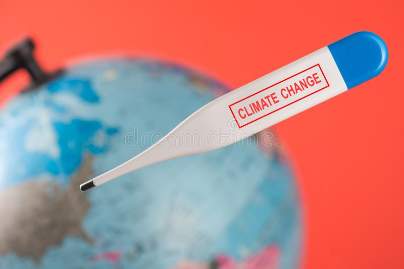 Sick earth with digital electronic thermometer royalty free stock images