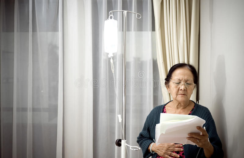 Sick elderly patient in hospital ward stock photos