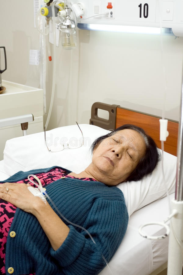 Sick elderly patient sleep in bed rest royalty free stock images