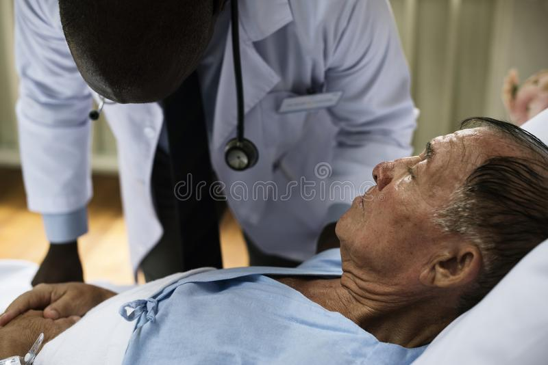 A sick elderly is staying at a hospital stock photos