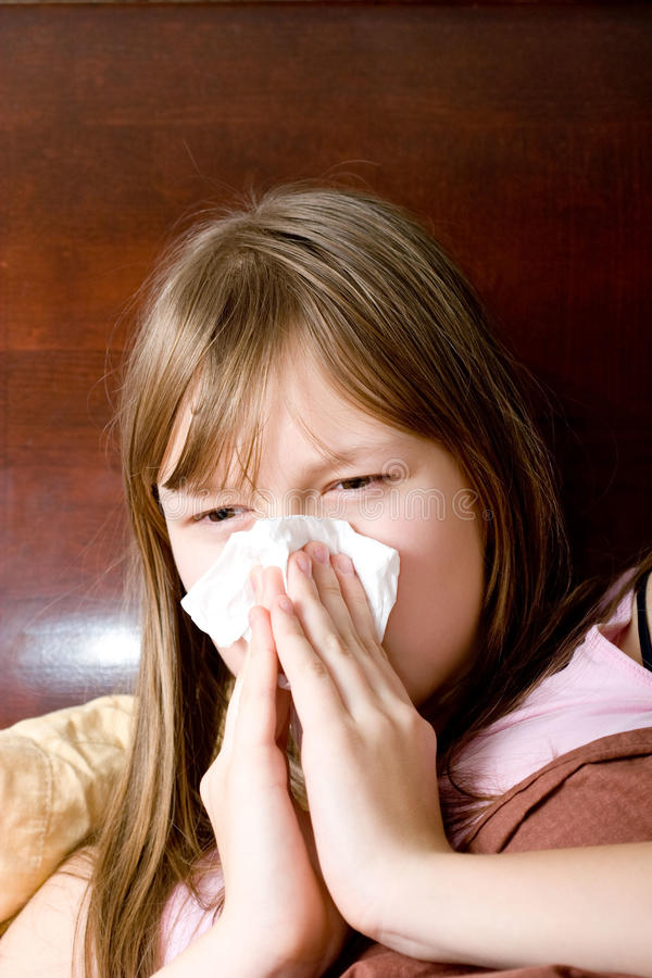 Download Sick With Flu Teenager Girl In Bed Sneezing Stock Image - Image: 12927431