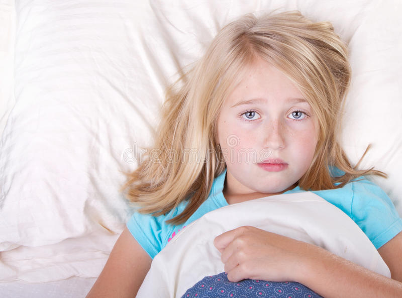 Sick Girl Laying In Bed Stock Photo