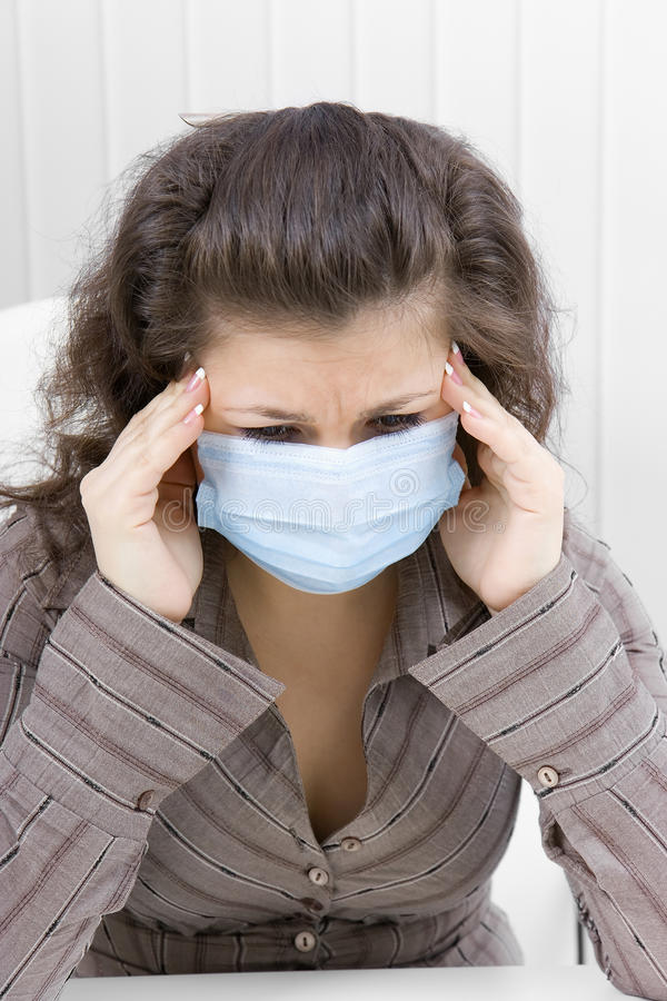 Download The Sick Girl With Medical Mask With Sad Eyes Stock Photo - Image: 13332610
