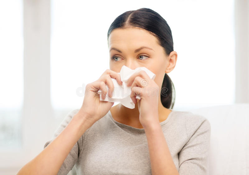 Sick girl with paper tissue stock images