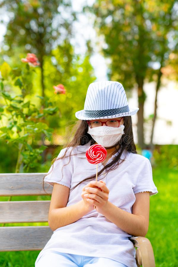 Sick girl staring at candy. royalty free stock images
