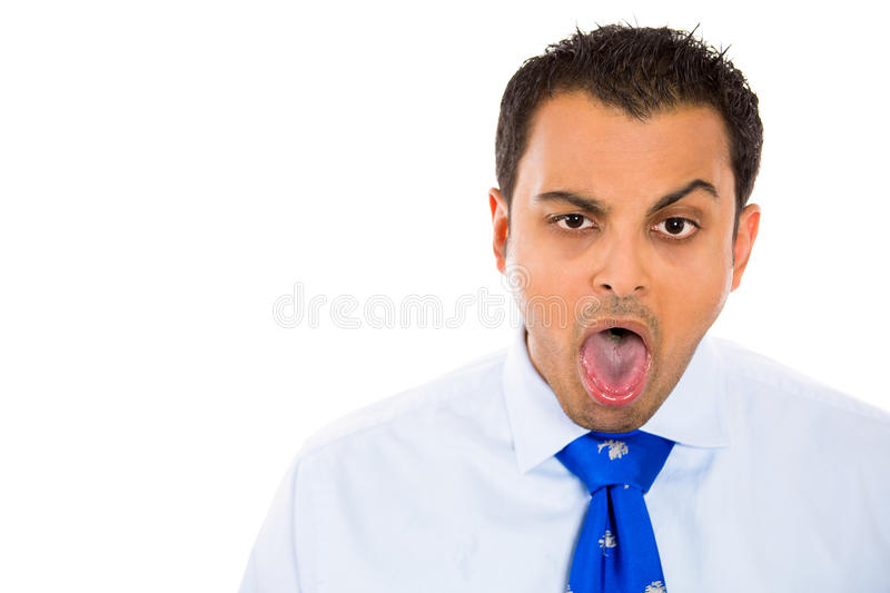 Sick and goofy guy. Sick man with goofy expression, mouth open, tongue out, about to vomit, isolated on white background with copy space to right stock photos