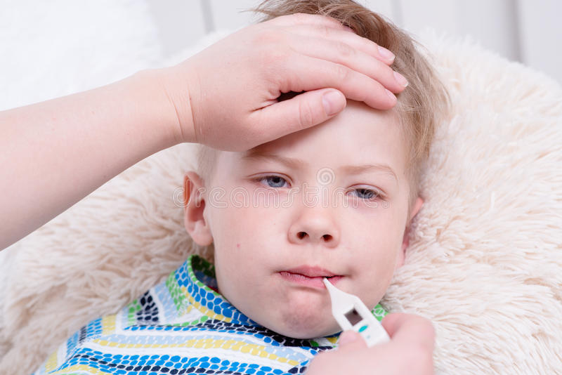 Sick kid with high fever laying in bed and mother taking temperature download sick kid with high fever laying in bed and mother taking temperature stock image altavistaventures Choice Image
