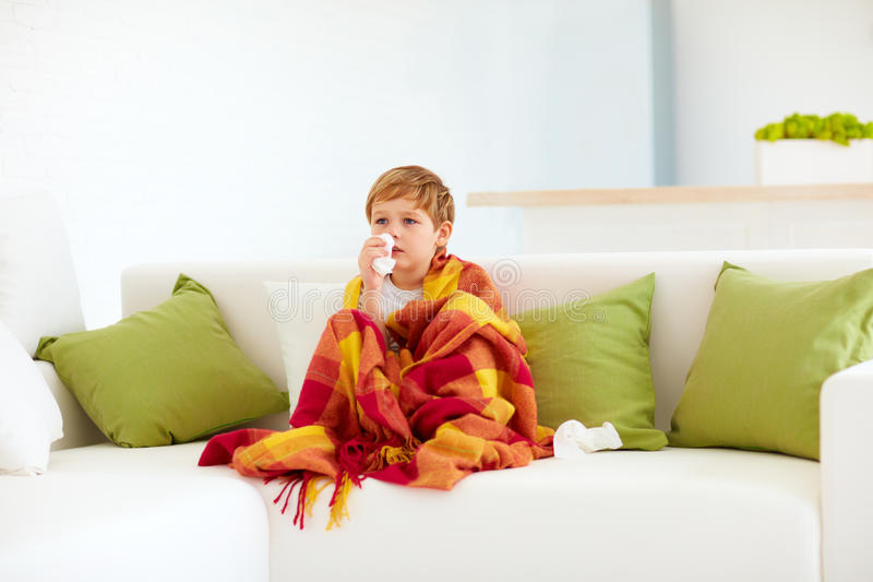 Sick kid with runny nose and fever heat at home. Sick kid, boy with runny nose and fever heat at home stock photos