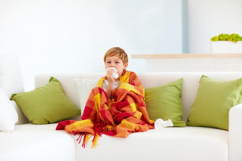 Sick kid with runny nose and fever heat at home. Sick kid, boy with runny nose and fever heat at home royalty free stock images