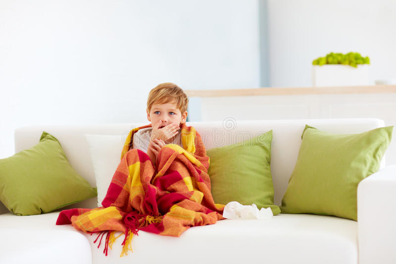 Sick kid with runny nose and fever heat at home. Sick kid, boy with runny nose and fever heat at home stock photo