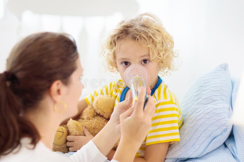 Sick little boy with asthma medicine. Ill child royalty free stock image