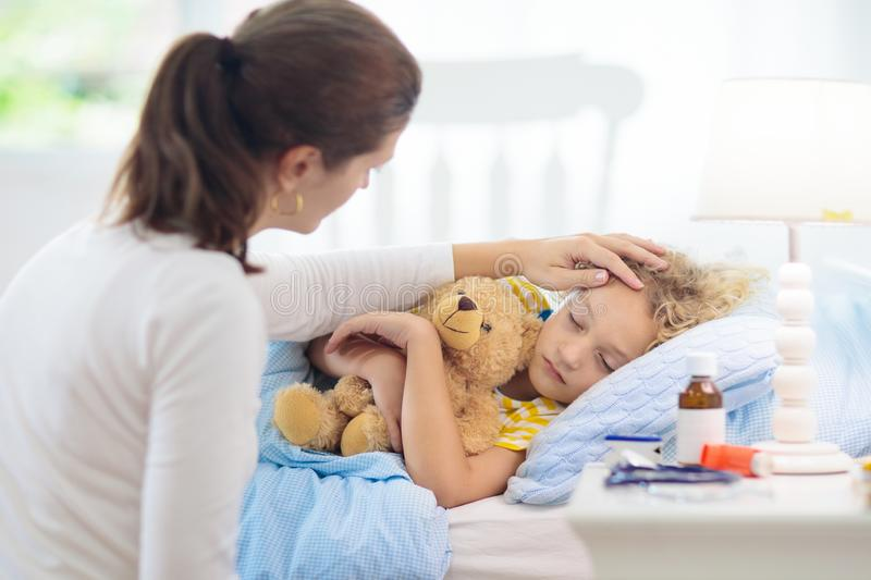 Sick little boy with asthma medicine. Ill child stock photography