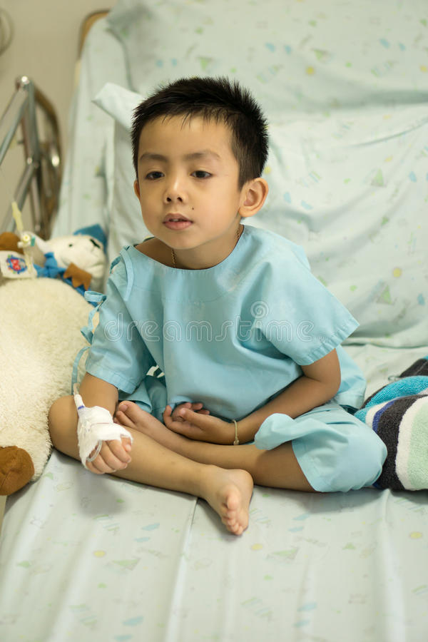 A sick Little boy in hospital bed. stock photography