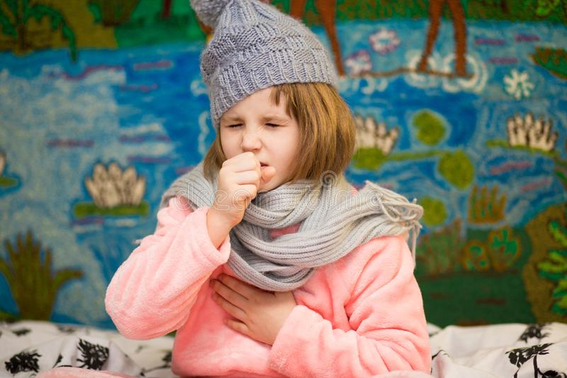 Sick little girl coughing with severe chest pain royalty free stock photos