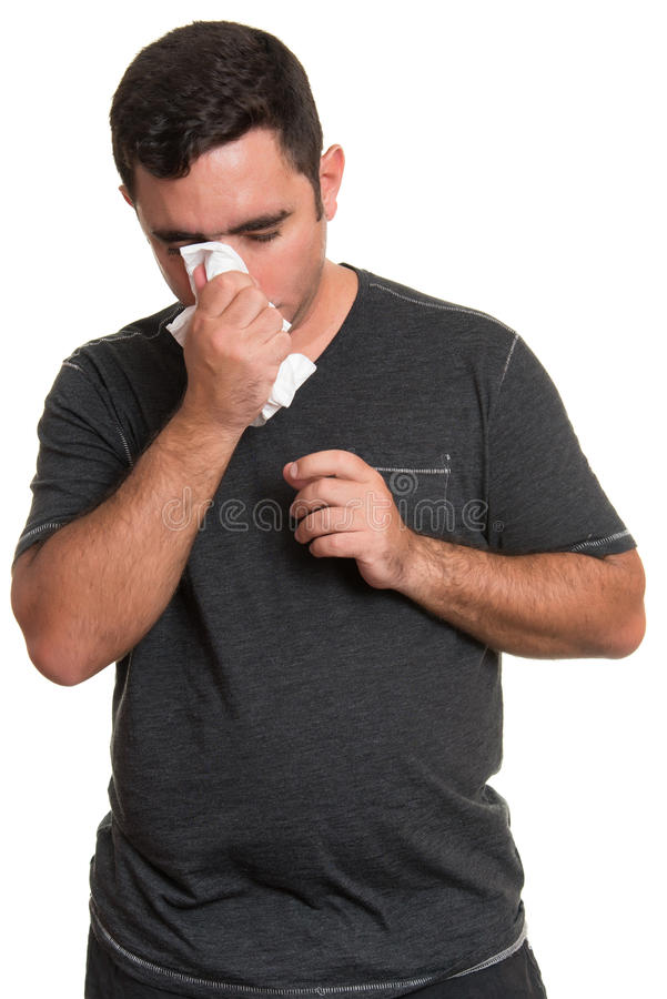 Sick man blowing his nose isolated on white stock image