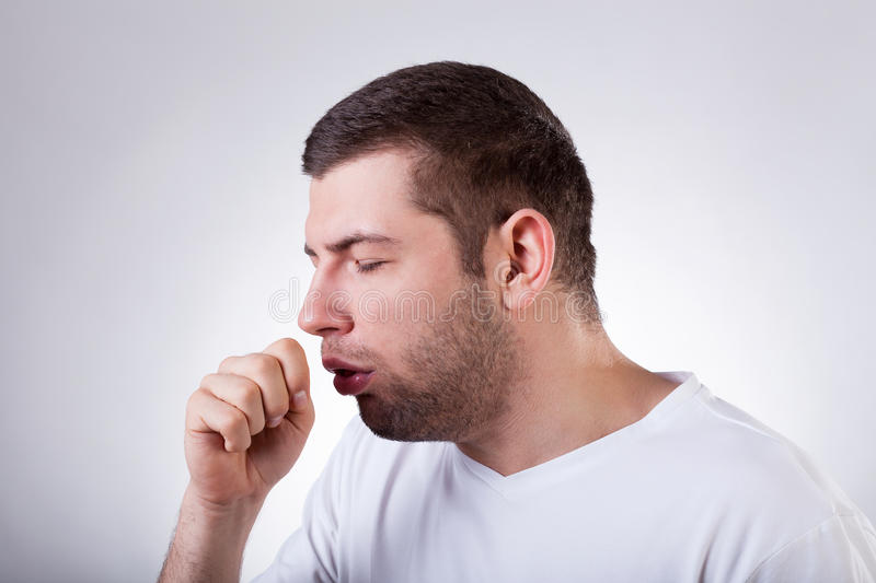 Sick man having a cough. Close-up of a young man having a cough