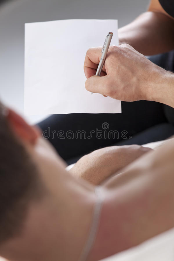 Sick man signs empty paper stock photo
