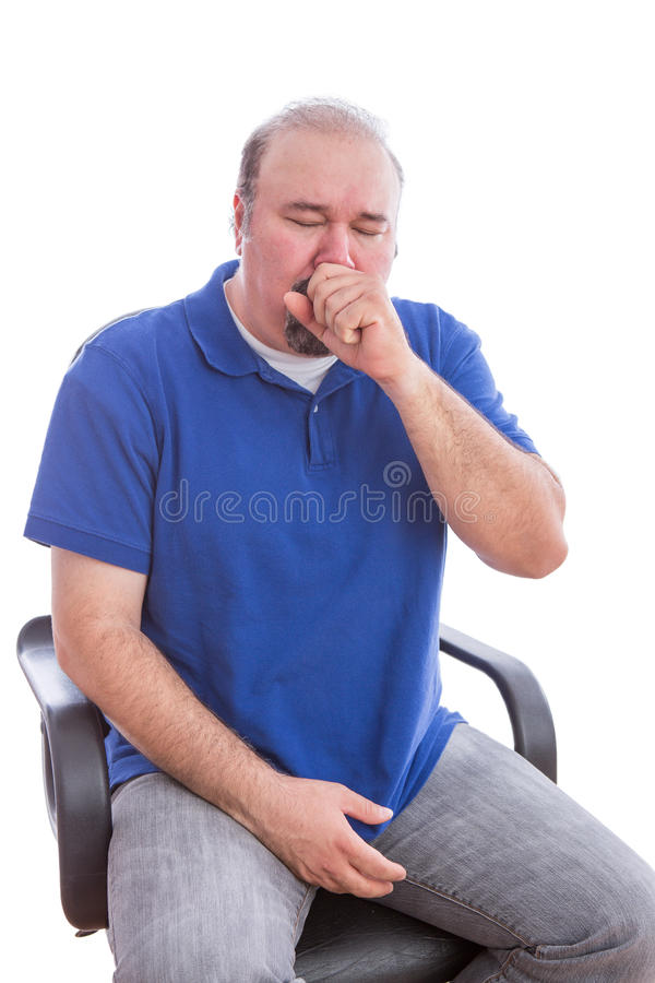 Sick Man Sitting on a Chair Suffering From Cough. Close up Sick Bearded Man in Blue Shirt Sitting on a Single Chair Suffering From Cough. Isolated on White stock image