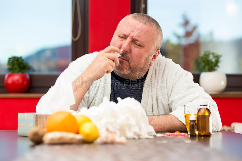 Sick man suffering cold and winter flu virus drinking tea.  stock images