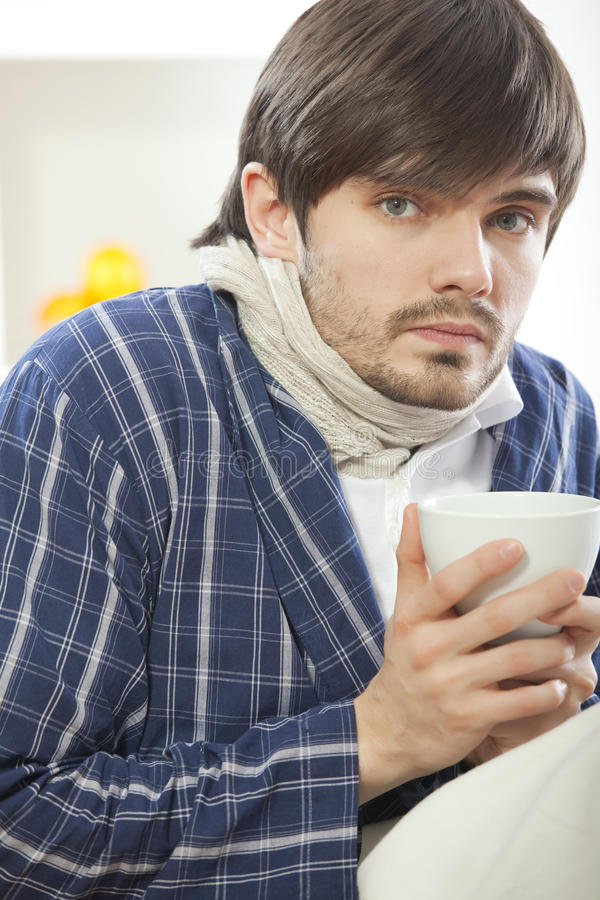 Free Sick Man With Cup Tea Royalty Free Stock Image - 17058806