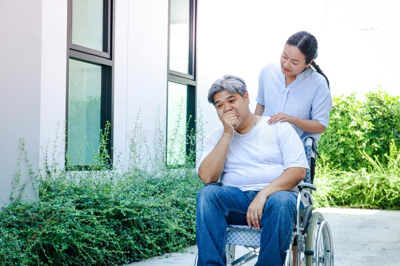 The elderly are sick, can`t walk, sit in a wheelchair. stock image