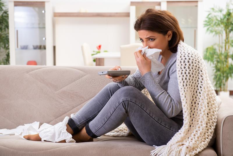 Sick middle-aged woman suffering at home stock image