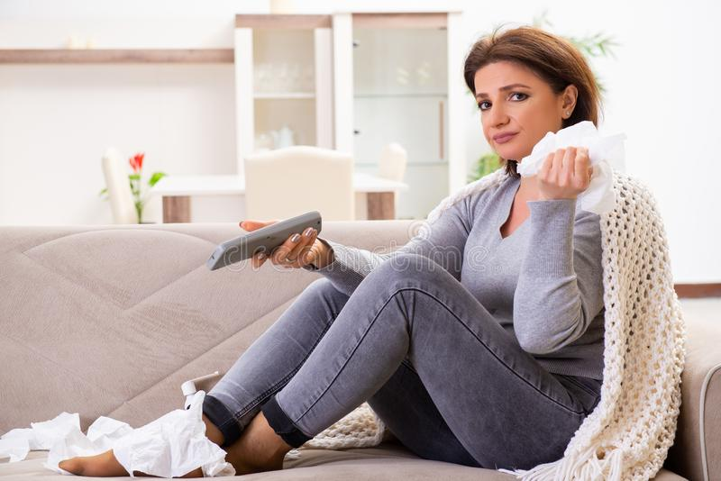 Sick middle-aged woman suffering at home stock images