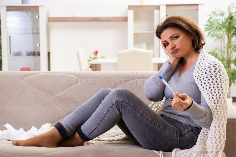 Sick middle-aged woman suffering at home royalty free stock photos