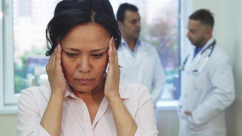 The sick patient felt a sharp headache during admission to the doctor stock photos